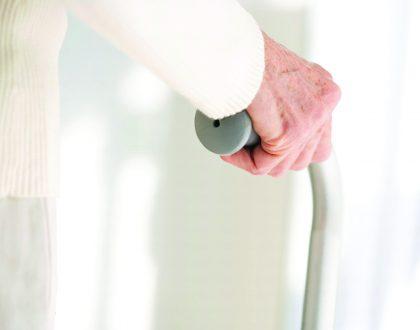 Elderly hand with cane