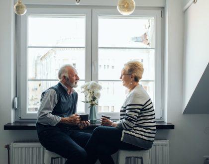 Elderly couple enjoying coffee together