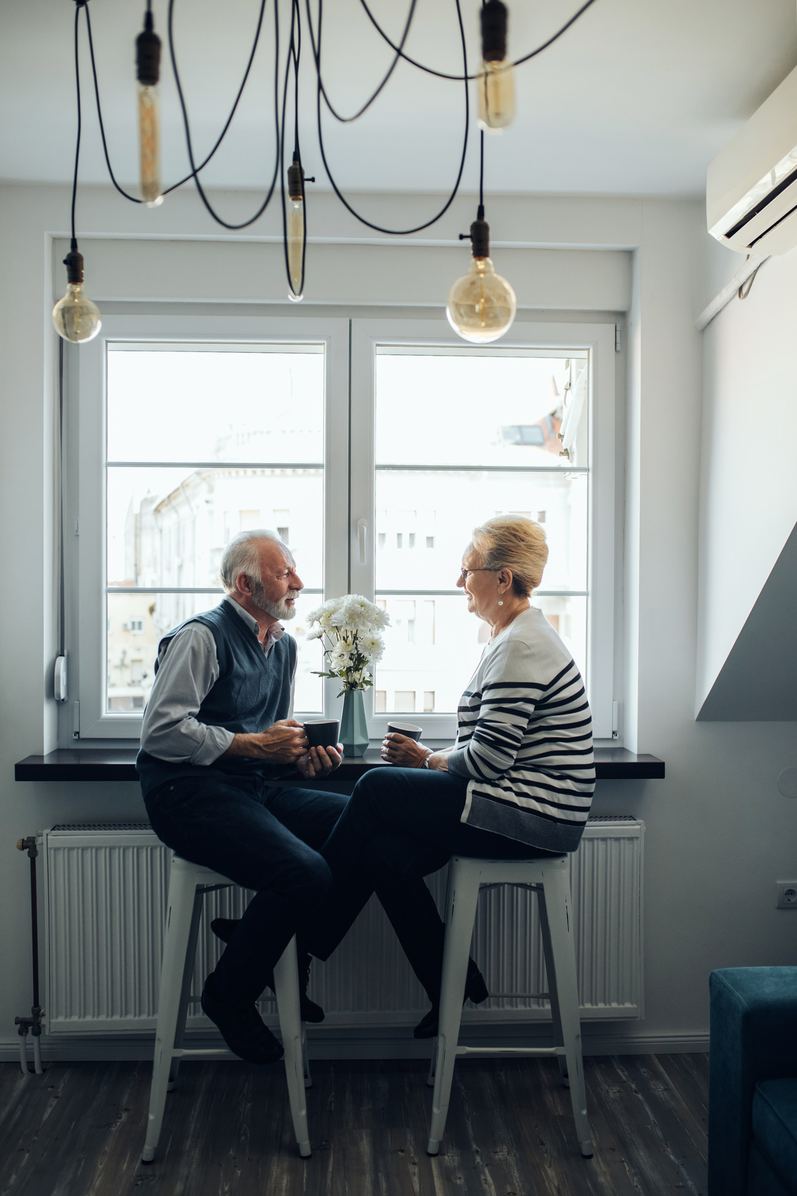 Elderly couple enjoying coffee together