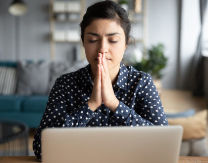 Indian woman pray make wish sit at home with laptop