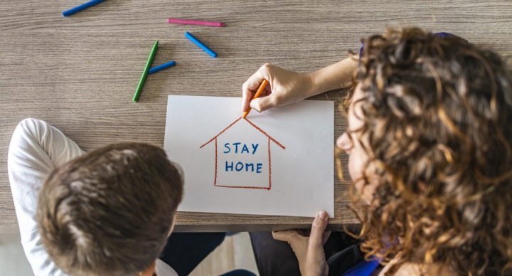 Mother and son drawing Stay Home logo. Coronavirus concept