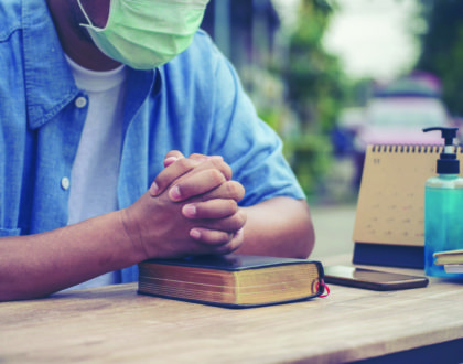 Prayer and bible concept. Asian senior man wear medical mask pra