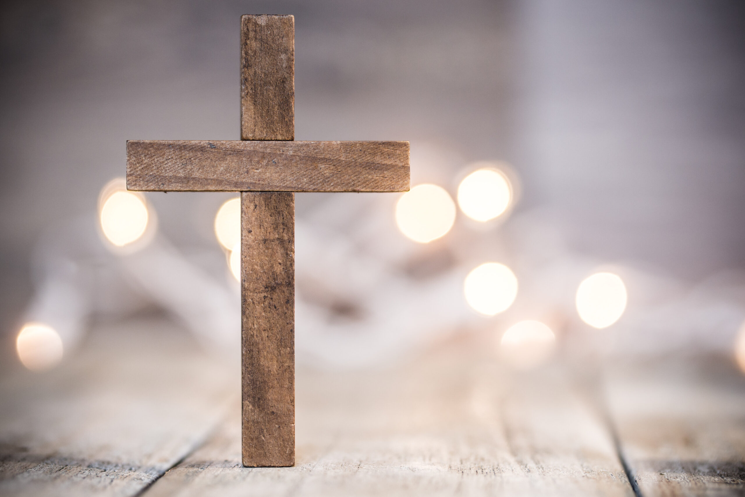 Christian Cross on a Soft Bokeh Background